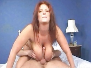 lusty redhead babe slurps on raging chubby schlong