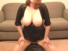 breasty lady riding a sybian