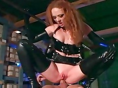 ginger banging in gloves and a latex uniform