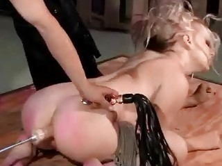 spanked when mechanism pierced inside the arse