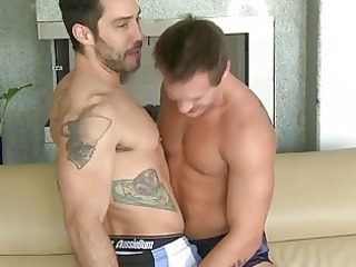 two muscled tattoed hunks give every different a